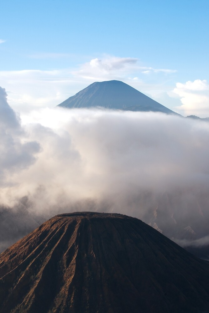 Mount Batok surrounded by white clouds. by Eduard Todikromo