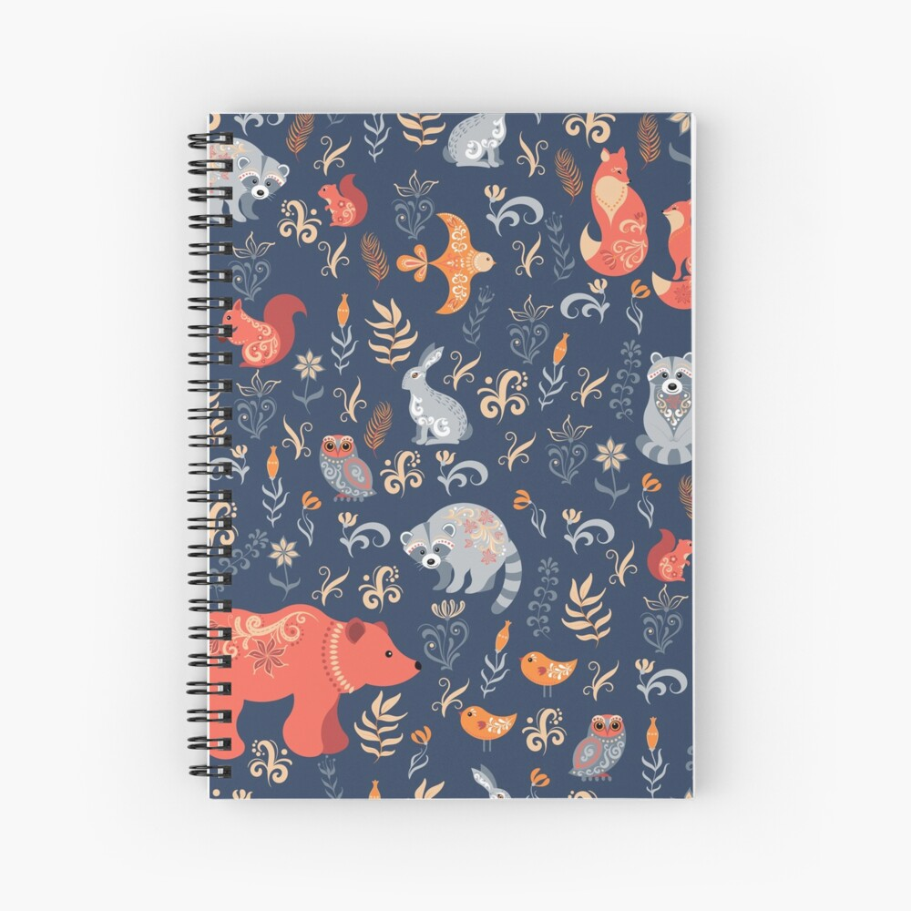 Fairy-tale forest. Fox, bear, raccoon, owls, rabbits, flowers and herbs on a blue background. Spiral Notebook