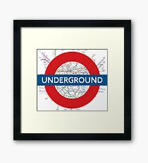 London Underground with tube map Framed Print
