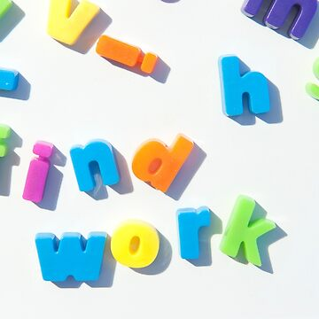 Fridge magnet letters spell find work. by stuwdamdorp