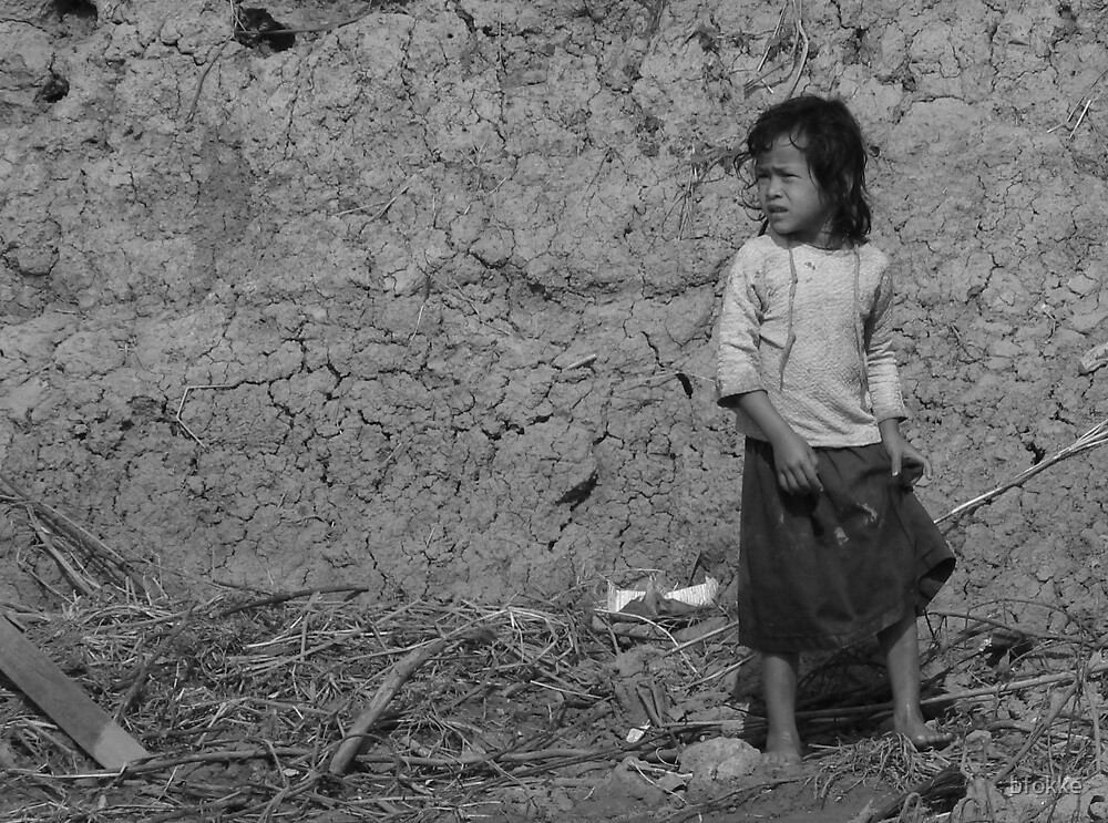Girl standing by the river near Tonle Sap lake, Cambodia by bfokke