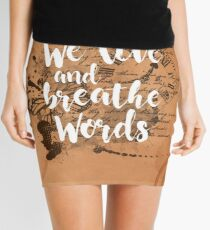 We live and breathe words Mini Skirt