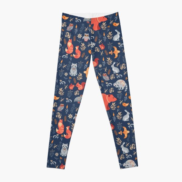Fairy-tale forest. Fox, bear, raccoon, owls, rabbits, flowers and herbs on a blue background. Leggings