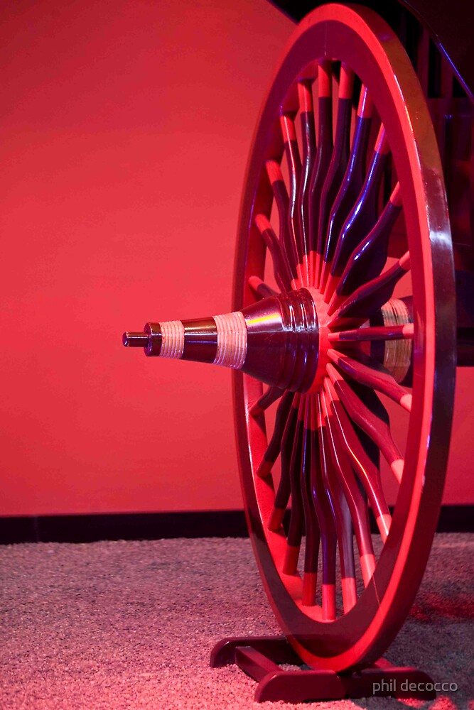 Rose Colored Carriage Wheel by phil decocco
