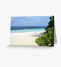 Beautiful island in the Maldives with vegetation, light sand and clear blue water Greeting Card