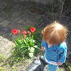 Young Boy with Tulips in the back garden by KABFA