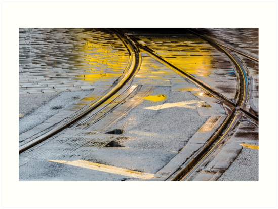 The city commute - Manchester tramlines - reflections in the rain by Chris Warham