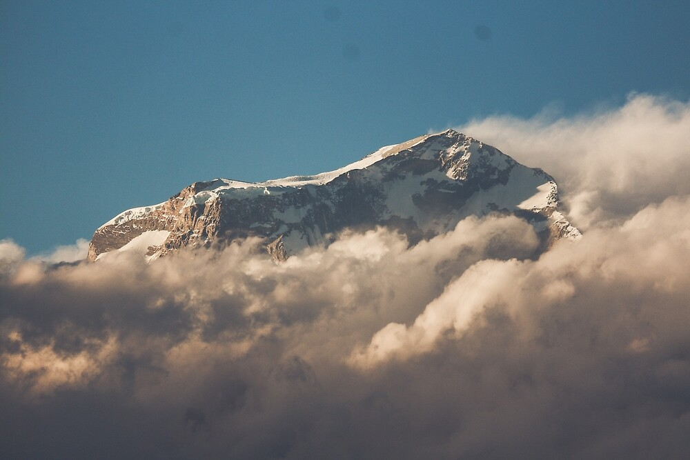 Mountain peak rising above the cloud by To The Moon And Back
