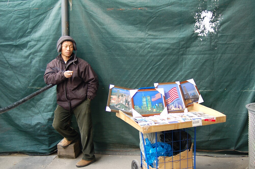 Guy selling photos of twin towers at ground zero by Jennifer Thomas