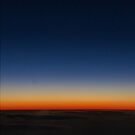 Sunrise from a plane by Caroline Gorka