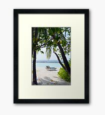 Lounge chairs on the beach in Maldives Framed Print