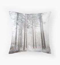Mysterious road in a frozen foggy forest Throw Pillow