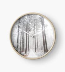 Mysterious road in a frozen foggy forest Clock