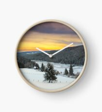 December sunrise over the mountain lake Clock
