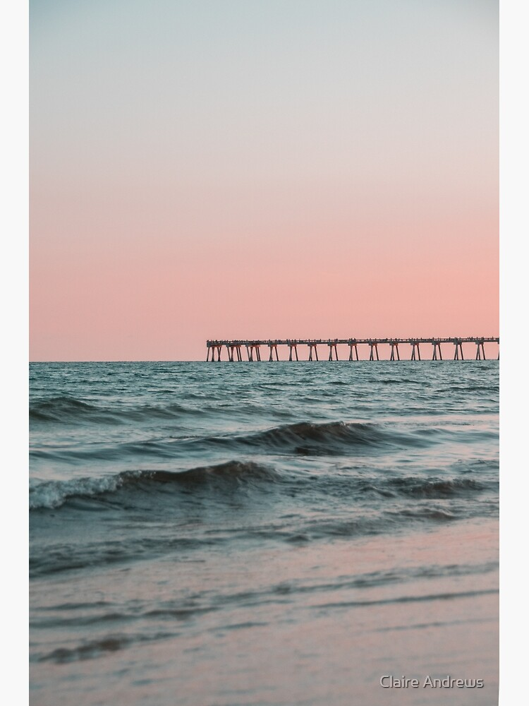 Pink Sky with Boardwalk Along the Ocean by Claireandrewss