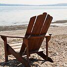 Chair and beach by Jaime Pharr