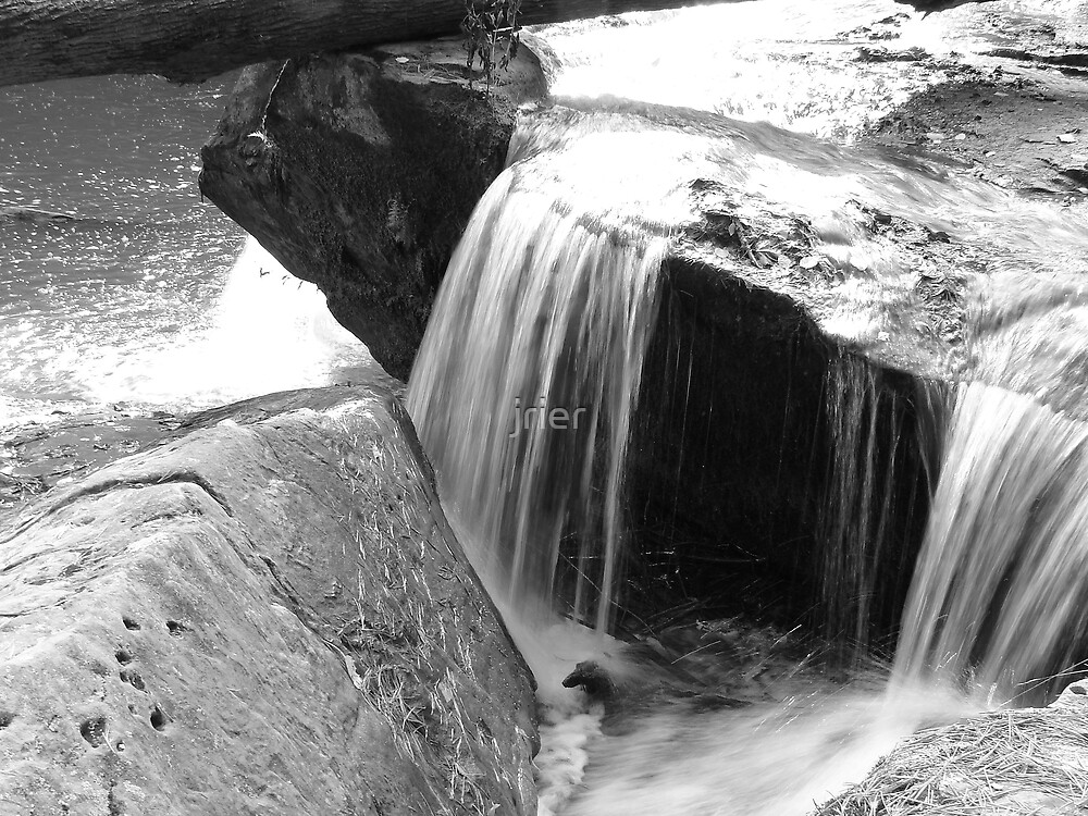 Close-up of waterfall by jrier