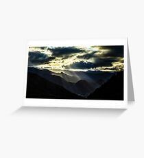 Sun rays lighting through the clouds in high Pyrenees, sunrise, green valley, France Greeting Card