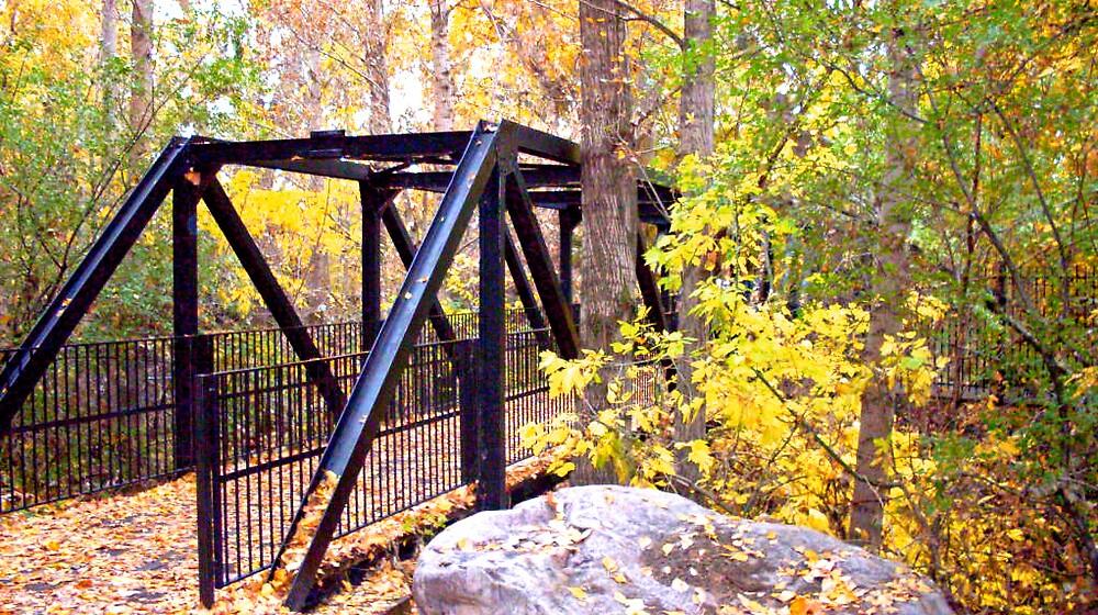 Farmington Trail Bridge in Autumn by Julie Gappmayer