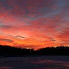 Frozen lake sunset by Nancy Hopping