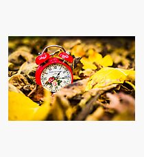 Red clock in autumn leaves Photographic Print