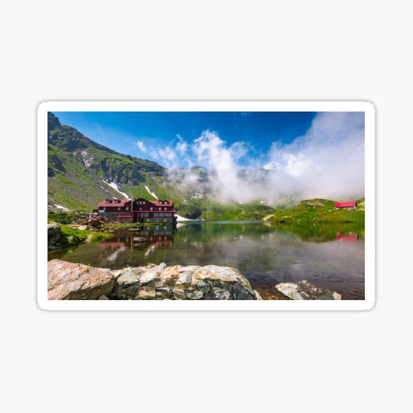 lake Balea in Fagaras mountains in foggy weather Sticker