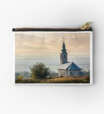 church on a hill at sunset Studio Pouch