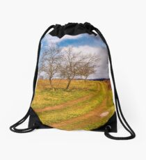 leafless trees along the dirt road up the hill Drawstring Bag