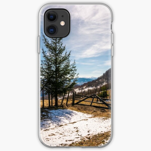 spruce trees near the fence on hillside iPhone Soft Case