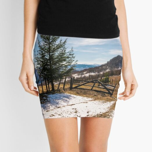 spruce trees near the fence on hillside Mini Skirt