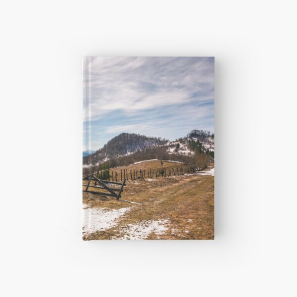 spruce trees near the fence on hillside Hardcover Journal