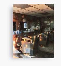 Barber Shop With Sun Shining Through Window Canvas Print