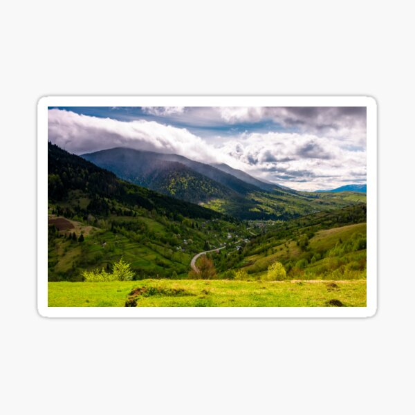 road through the village in valley of Carpathians Sticker