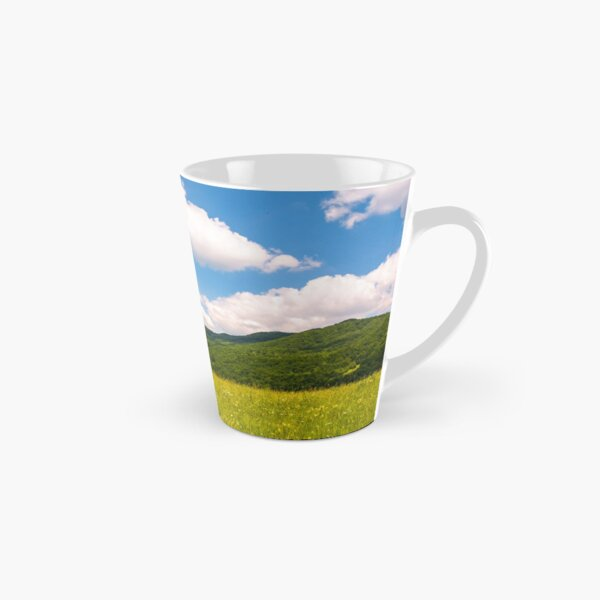 haystack on a grassy pasture in mountains Tall Mug