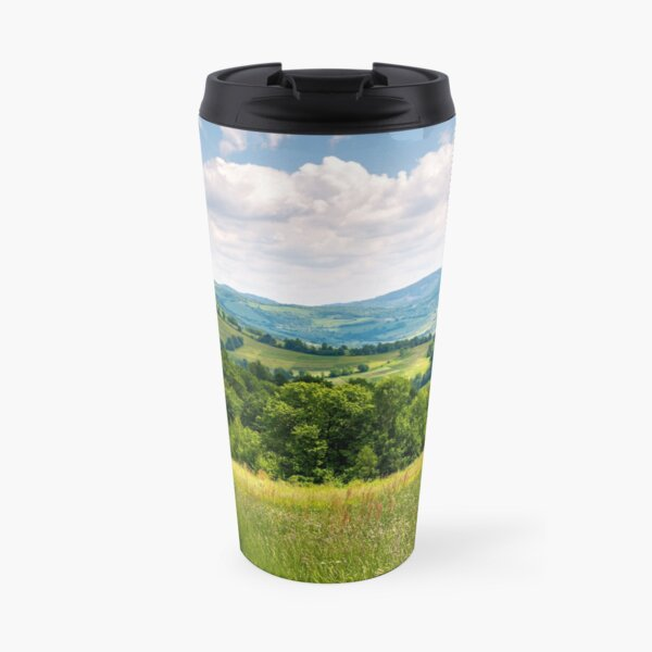 grassy fields in mountainous rural area Travel Mug