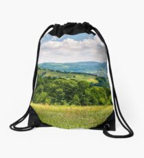 grassy fields in mountainous rural area Drawstring Bag
