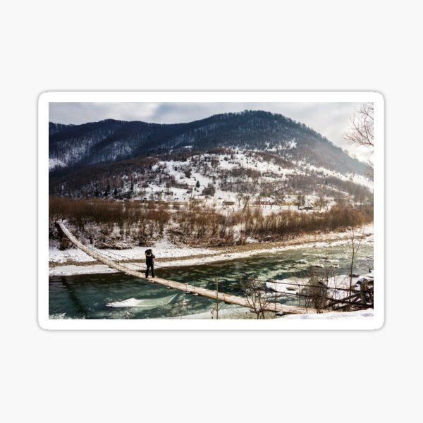 cold flow of river in snowy mountains Sticker