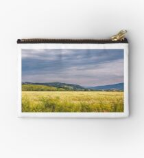 countryside summer landscape with field, forest and mountain ridge Studio Pouch