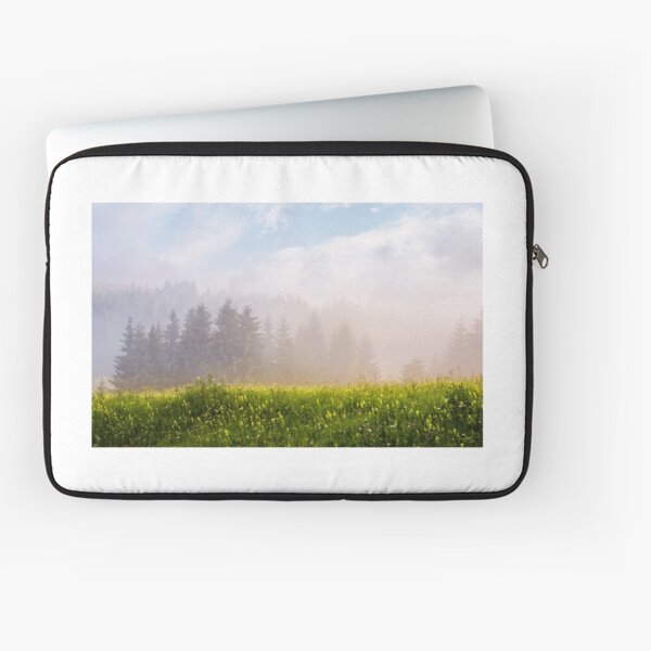 foggy sunrise in spruce forest Laptop Sleeve