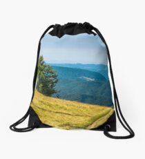 countryside road through grassy hill Drawstring Bag