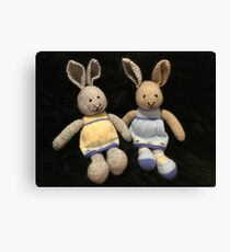 Knitted girl rabbits Canvas Print