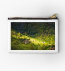 spot of light on forested hillside Studio Pouch