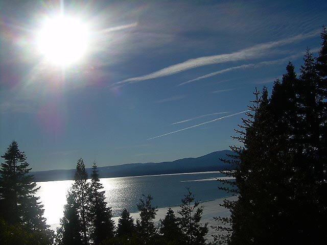 Winter Sun Over Lake Almanor by Edward Henzi