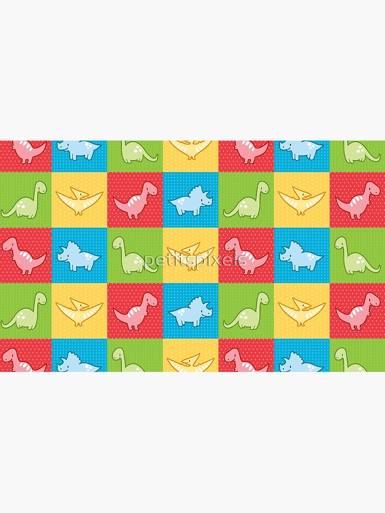Colorful dinosaurs and pterodactyl cheater quilt by petitspixels