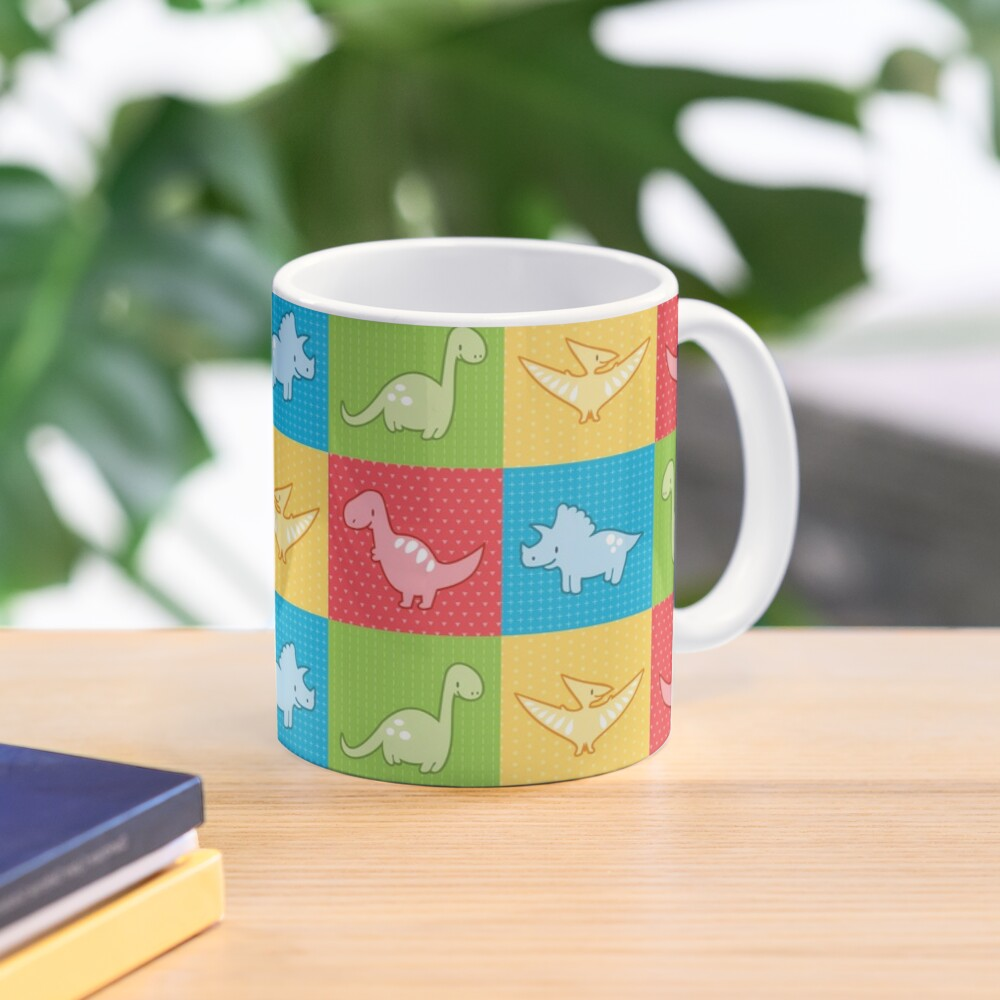 Colorful dinosaurs and pterodactyl cheater quilt Mug