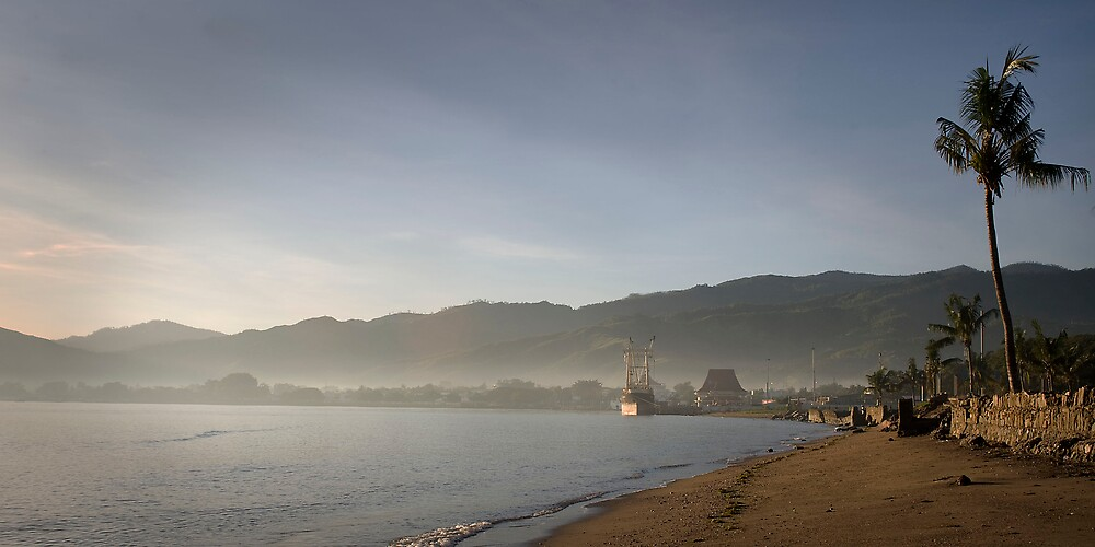 Port at dawn, Dili, East Timor by John Tozer
