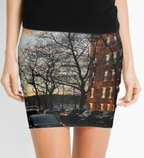 Evening, sunset, evening glow, the rays of the setting sun in the Windows, pink clouds Mini Skirt
