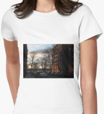 Evening, sunset, evening glow, the rays of the setting sun in the Windows, pink clouds Women's Fitted T-Shirt