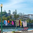 Watching the washing, Tavira, Portugal by Sue Knowles