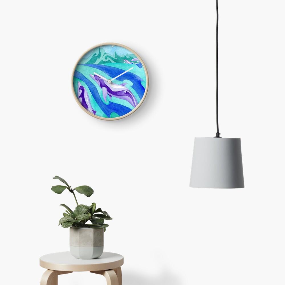 Polynesian dolphins swimming in Moorea Clock